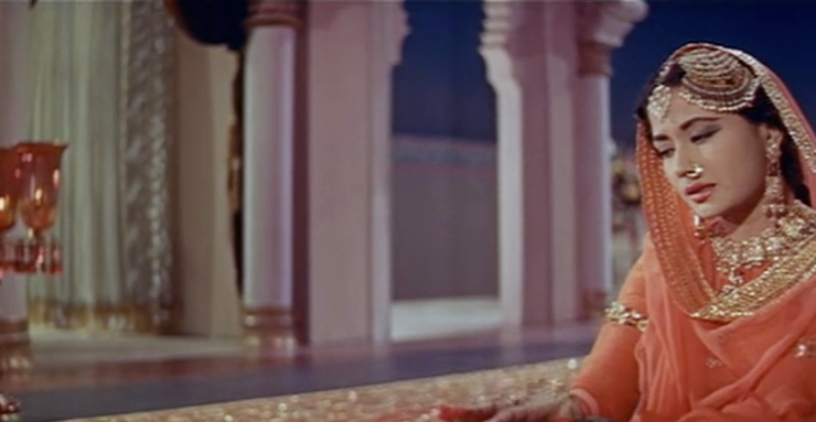 "Meena Kumar shines as Pakeezah in the beloved mujra song ""Chalte Chalte."""