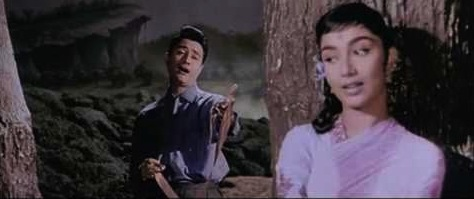 Dev Anand croons to Sadhana in a moonlit forest in Hum Dono (1961).