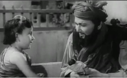 Balraj Sahni befriends a young girl who reminds him of his daughter back home in Afghanistan in Kabuliwala (1961)