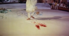 Pakeezah's blood begins to stain the white sheets on which she dances.