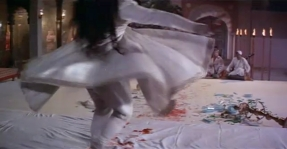 A close-up of Pakeezah's swirling white kathak dress. The audience begins to become dizzy as well.
