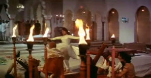 Just before her collapse, Pakeezah dances among the flames, burning in her own despair.