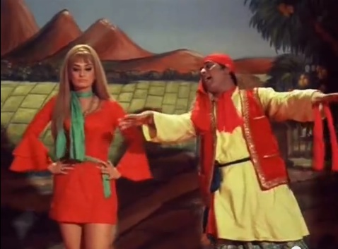 Saira Banu looks on in disgust as Manoj Kumar ruins classic English songs with Panjabi dhamaka in Purab Aur Paschim (1970).