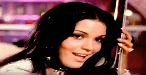 Zeenat Aman pretending to play guitar in Yaadon ki Baraat